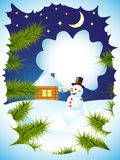 Winter card. With view through the spruce branches on snowman and house Royalty Free Stock Image