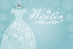 Winter card.Bridal dress with snowflake lace. Winter greeting card,poster,background.Openwork white wedding dress.Lace from a snowflake.Falling snowflakes Royalty Free Stock Photography