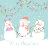Winter card with cartoon cute snowmen with a multi-colored garland in pastel colors. Funny  snowmen in childish style. Perfect for winter invitations, New Year Stock Photo