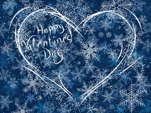 Winter card of snowy Valentine's heart. Stock Image
