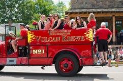 Winter Carnival Crew at Mendota Parade. Mendota, Minnesota, USA – JULY 8, 2017: The Vulcan Krewe of Saint Paul Winter Carnival lore waves to crowd from Stock Image