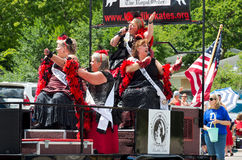 Winter Carnival Crew Sings at Parade. Mendota, Minnesota, USA – JULY 8, 2017: Klondike Kates of Saint Paul Winter Carnival lore sing to crowd from motorcade Royalty Free Stock Photo