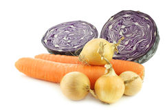 Winter carrots, brown onions and a cut red cabbage Stock Photo