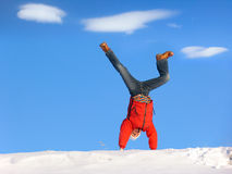 Winter Cartwheel. Cartwheel on the snow under blue sky Royalty Free Stock Image