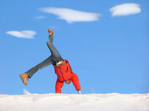 Winter Cartwheel. Cartwheel on the snow under blue sky Stock Photos