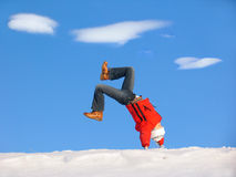 Winter Cartwheel. Cartwheel on the snow under blue sky Royalty Free Stock Photography