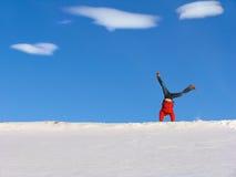 Winter Cartwheel. Cartwheel on the snow under blue sky Royalty Free Stock Photos