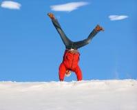 Winter Cartwheel. Cartwheel on the snow under blue sky Stock Photo