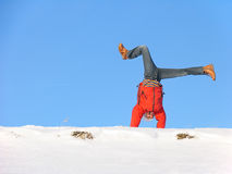 Winter cartwheel. Somersault on the snow under the blue sky Stock Photos