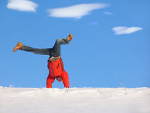 Winter Cartwheel. Cartwheel on the snow under blue sky Stock Photography