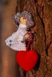 Winter celebrations beautiful background. Small White dolls angels. winter celebrations beautiful background Royalty Free Stock Photo