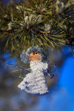 Winter celebrations beautiful background. Small White dolls angels with sprig of pine sprinkled with snow. winter celebrations beautiful background Royalty Free Stock Photo