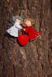 Winter celebrations beautiful background. Two small dolls angels. winter celebrations beautiful background Royalty Free Stock Photo