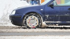 Winter chains car wheels Royalty Free Stock Photos