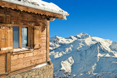 Winter chalet in french alps. Mont blanc on blue sky background royalty free stock photo