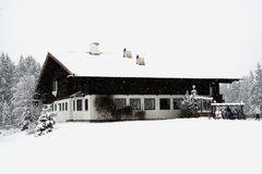 Winter Chalet in Snow Storm Stock Images