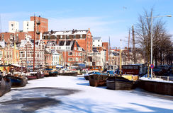Winter on the channel in Groningen. View on white channel covered with snow in Groningen, Netherlands Royalty Free Stock Photos