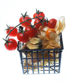 Winter cherry and tomatos in the basket Stock Photos