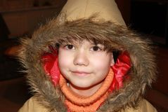 Winter child. Little boy enjoy first snow in november and is ready go out Stock Photography