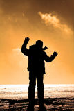 Winter child. Winter silhouette, child is throwing snow in the air Stock Image