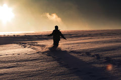 Winter child. Winter silhouette, child is throwing snow in the air Royalty Free Stock Photos