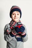 Winter Child Boy drink Tea or Coffee. Winter Clothes. Sweater, H Stock Images