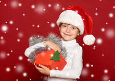 Winter, child,  christmas concept - happy girl in santa hat with Royalty Free Stock Photography