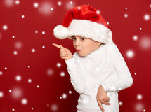 Winter, child,  christmas concept - happy girl in santa hat danc Stock Photography