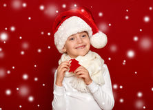 Winter, child,  christmas concept - happy girl in santa hat show Royalty Free Stock Photo