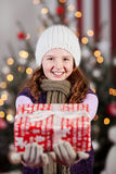 Winter child with Christmas gifts Royalty Free Stock Photos