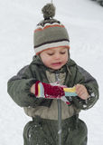 Winter child with gloves Royalty Free Stock Photography