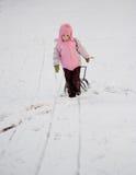 Winter child toboggan Royalty Free Stock Images