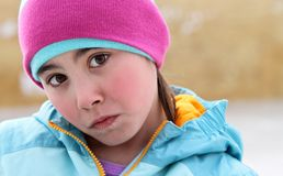 Winter child wearing a frown Royalty Free Stock Images