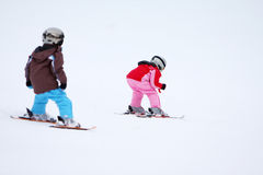 Winter children ski in snow Stock Photo