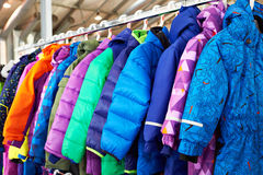 Winter children sports jacket on hanger in store Royalty Free Stock Photo