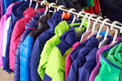 Winter children sports jacket on hanger in store Royalty Free Stock Images