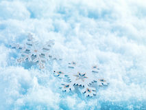 Winter and Christmas background. Beautiful sparkling silver and red Christmas decoration on a white snow background. Stock Images