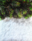 Winter Christmas background. Christmas boarder with fir tree branch with cones on the snow. Winter holidays concept. Stock Photography