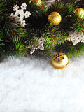 Winter Christmas background. Christmas boarder with fir tree branch with cones on the snow. Winter holidays concept. Royalty Free Stock Photography