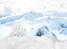 Winter Christmas background. Christmas decorations in a snowdrift in front of snowy mountains. Winter Christmas background Royalty Free Stock Images