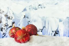 Winter Christmas background. Christmas decorations in a snowdrift in front of snowy mountains. Winter Christmas background Stock Image