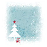 Winter Christmas background with Christmas tree. Grungy and frosty blue Christmas card with scratches, stains and snowflakes in the background and a simple Royalty Free Stock Image