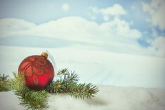 Winter Christmas background. Christmas decorations in a snowdrift in front of snowy mountains. Winter Christmas background Stock Photo