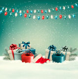 Winter christmas background with gifts and a garland.