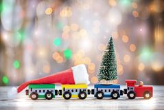 Winter Christmas background Miniature colorful train with fir tree. Holiday greeting card.  stock photo