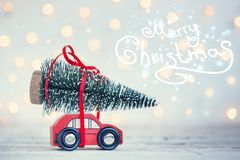 Winter Christmas background Miniature red car with fir tree. Holiday greeting card royalty free stock photo