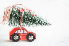 Winter Christmas background Miniature red car with fir tree. Holiday greeting card royalty free stock photography