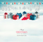 Winter christmas background with presents and a garland. Stock Photos