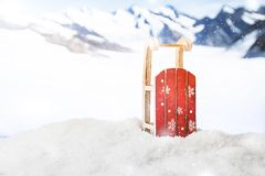Winter Christmas background. Sleigh in a snowdrift in front of snowy mountains. Winter Christmas background Stock Photos