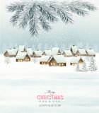 Winter christmas background with a snowy village landscape. Royalty Free Stock Image